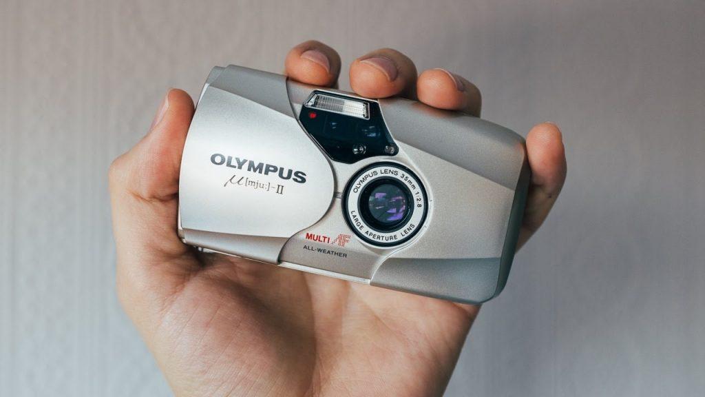 """""""Mju II""""-กล้องในมือ"""